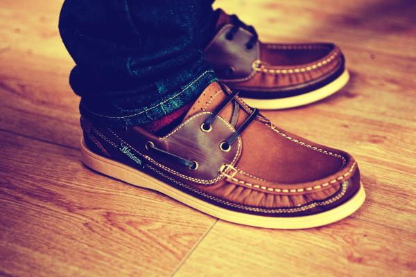 man wearing loafers on hardwood floor